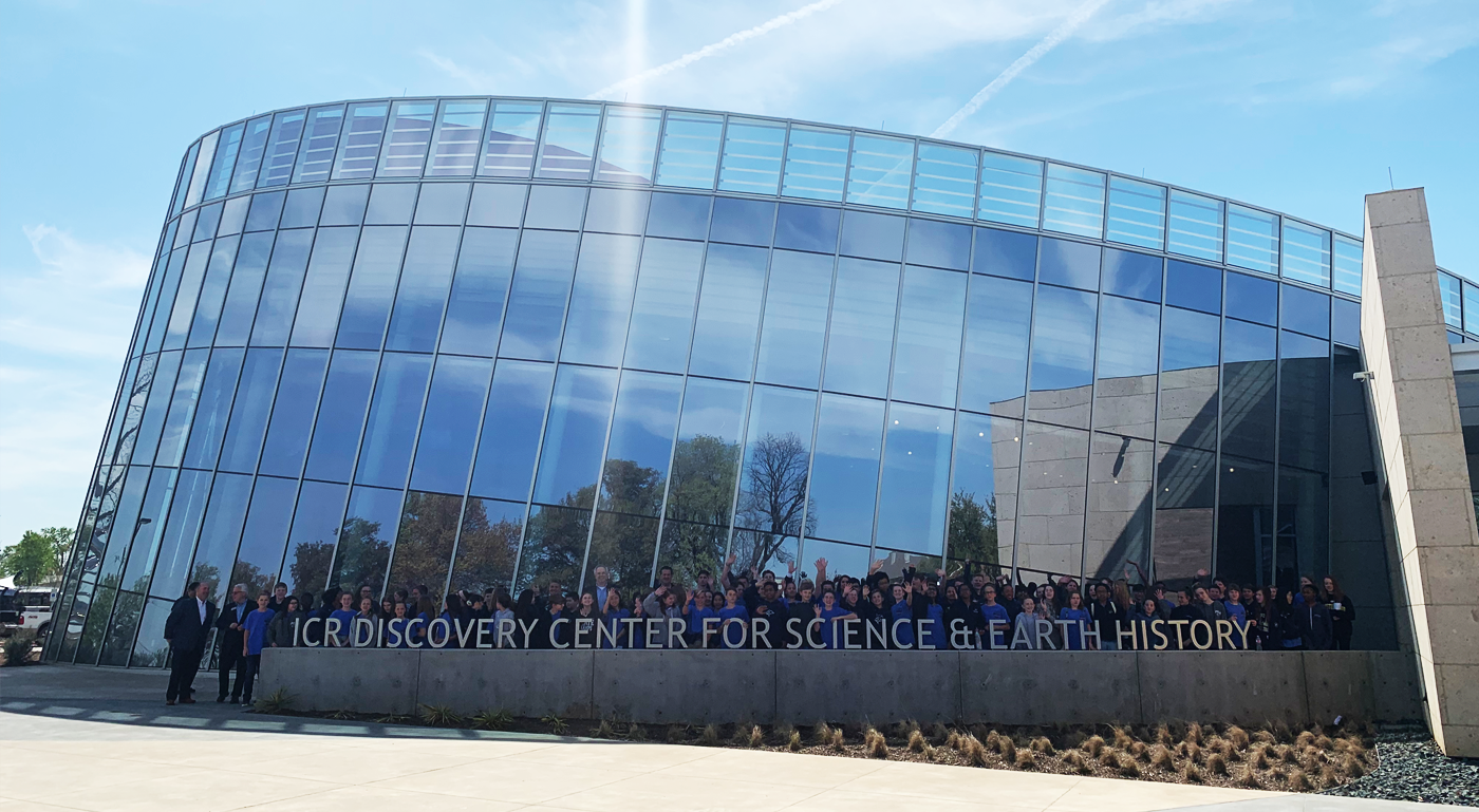 School Group posing behind ICR Discovery Center for Science & Earth History sign.